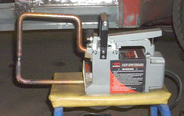 Spot welder with extended tongs